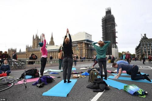 Westminster Bridge yoga. PA
